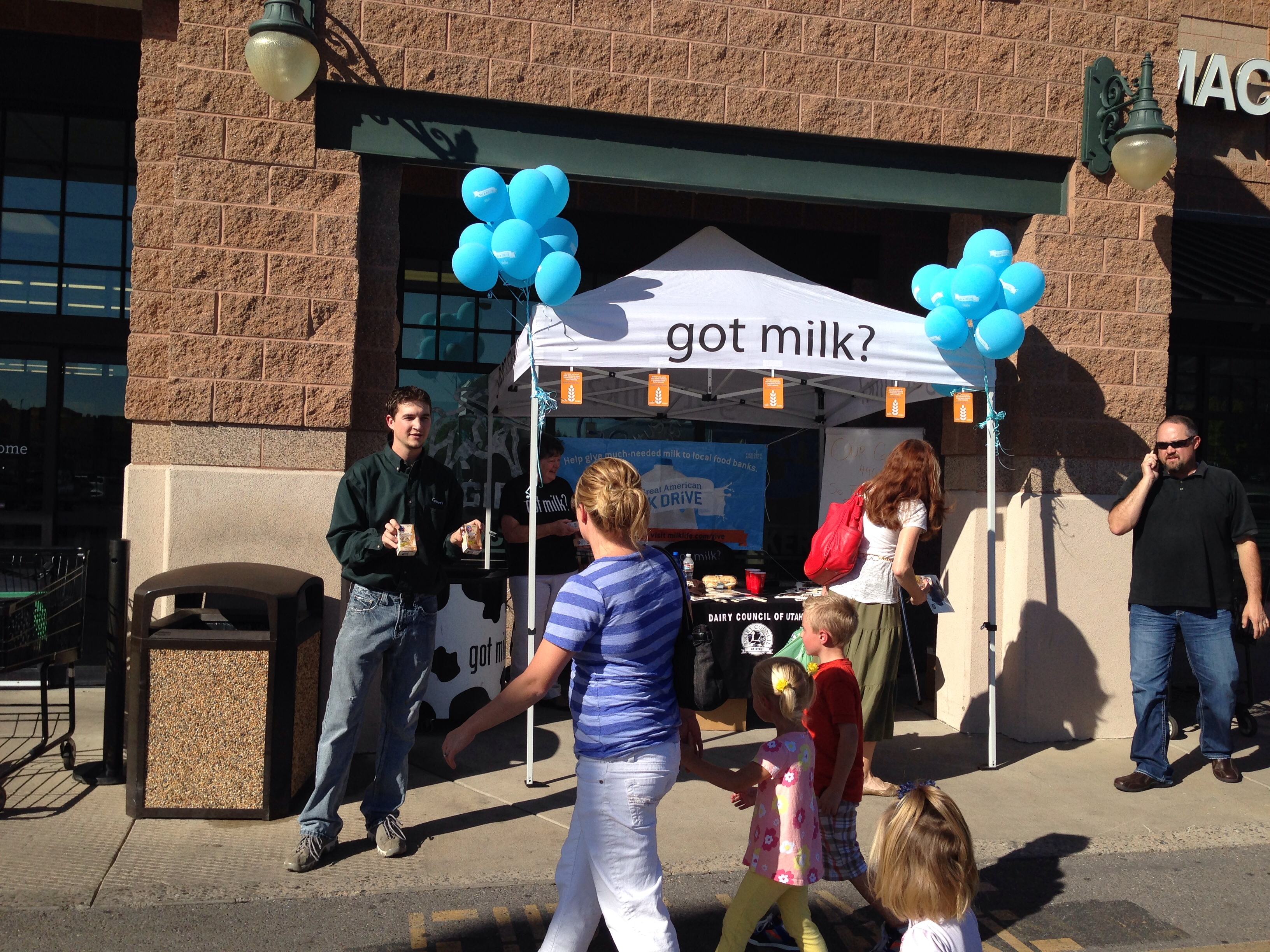 Gossner Foods helps pass out free chocolate milk at a Lee's Marketplace store in Logan, UT