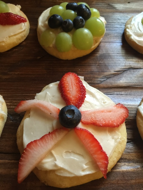 Decorating sugar cookies with fruit